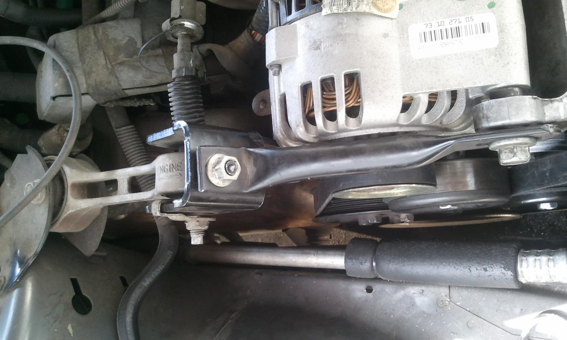 D Where Does Bracket Go on 2003 Ford Taurus Timing Cover
