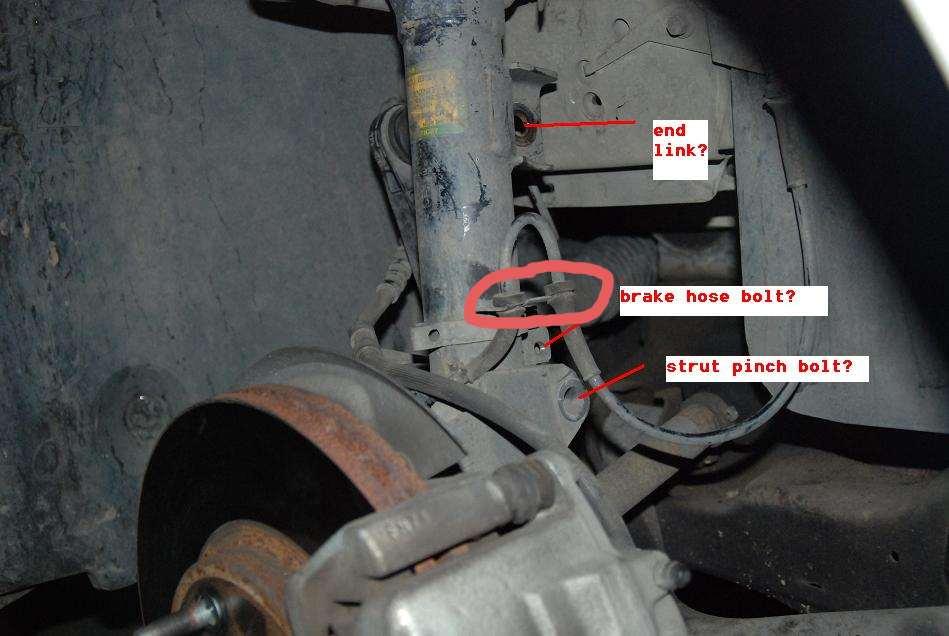 maintenance repair. stop work mercury sable front wheel assembly.